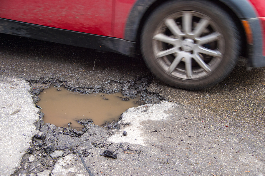 Spring Driving Dangers: Potholes and Hydroplaning